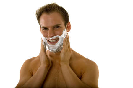 Young male putting shaving cream on his face Stock Photo - 3541617
