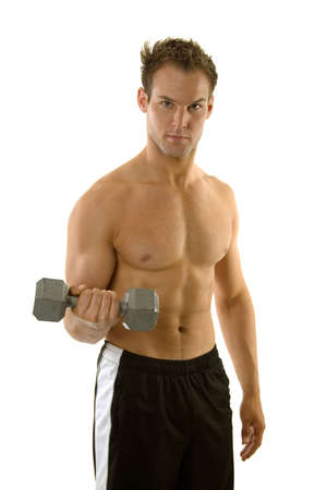 Young male exercising with dumbbells photo