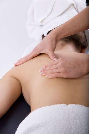 Massage therapist giving a massage Stock Photo - 3563067