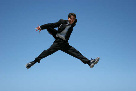 ecstatic: Ecstatic businessman jumping in the air Stock Photo