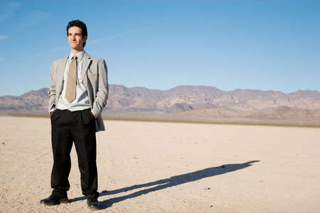 Young businessman in the desert Stock Photo - 3567998