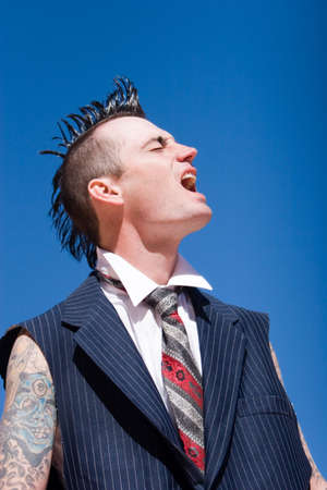 haircut: Man with mohawk style haircut and alternative fashion outfit