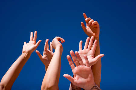 Group of people hands in the air Stock Photo - 3568531