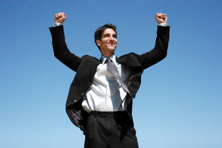 Successful businessman jumping to celebrate