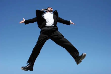 Successful businessman jumping to celebrate Stock Photo - 3568490