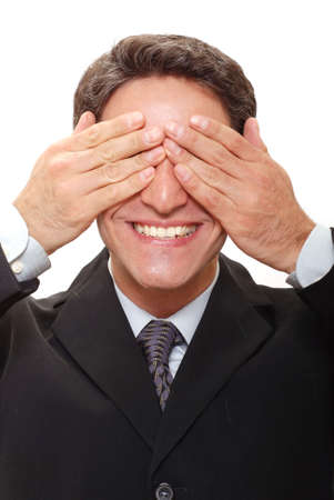 Businessman with hands over his eyes