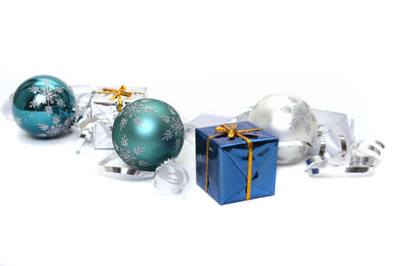 Christmas ornaments and gift boxes on white background photo