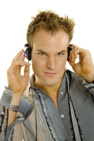 haircut: Young male listening music with headphones Stock Photo