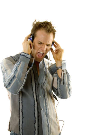 Young male in casual outfit listening music