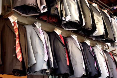 Suits lined up in a store