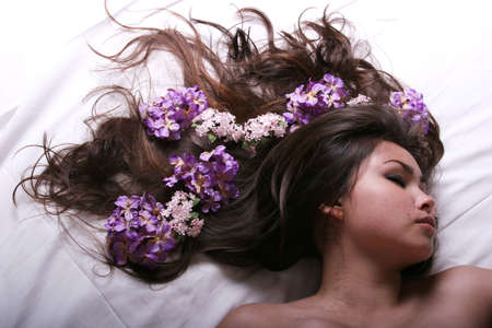 Beautiful asian woman lying on bed