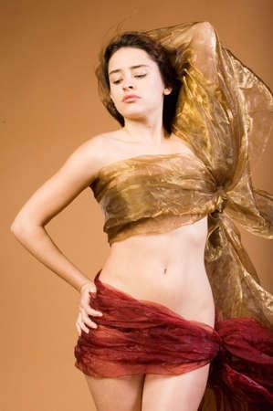 Beautiful woman wrapped in silk photo