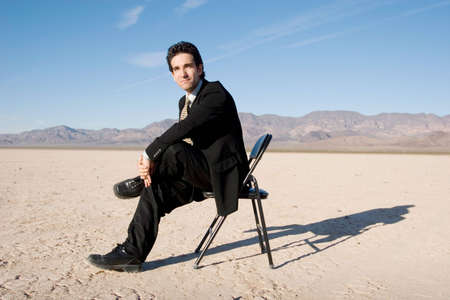 Businessman sitting on a chair Stock Photo - 3766641