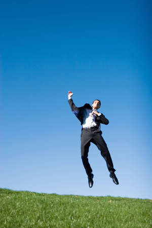Businessman jumping in the air photo
