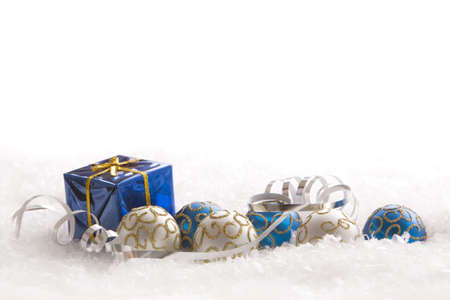 Christmas gift and ornaments in snow Stock Photo