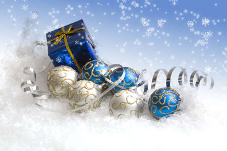 blue box: Christmas gift and ornaments in snow Stock Photo
