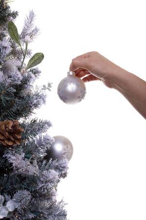 decorating christmas tree: Woman decorating her Christmas tree Stock Photo