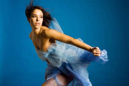 Beautiful woman in silk dancing photo
