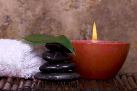 Balanced pebble rocks, candle, white towel set on bamboo for spa treatment Stock Photo - 4000793