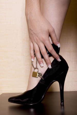 high heeled shoe: Womans leg and high heeled shoe