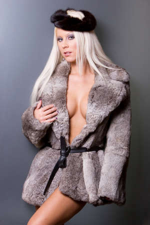 winter fashion: Sexy blonde woman in fur coat Stock Photo