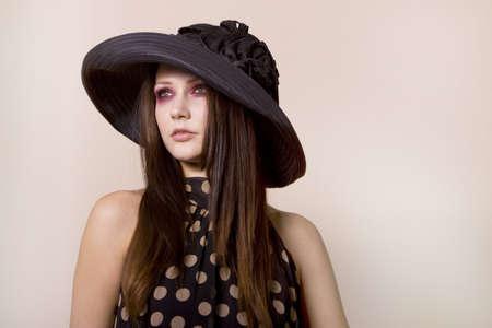 Beautiful fashionable young woman in polka dot dress Stock Photo - 4108197