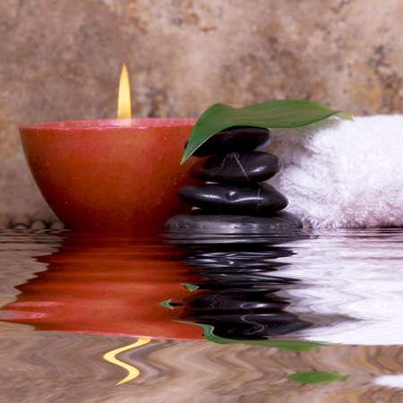 Balanced pebble rocks, candle, white towel set on bamboo for spa treatment Stock Photo - 4200423