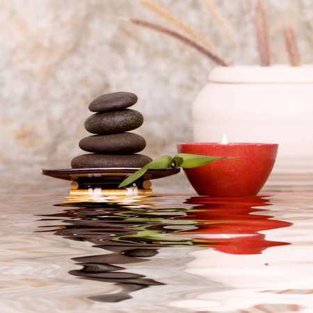Massage stones and candle on antique background Stock Photo - 4200409