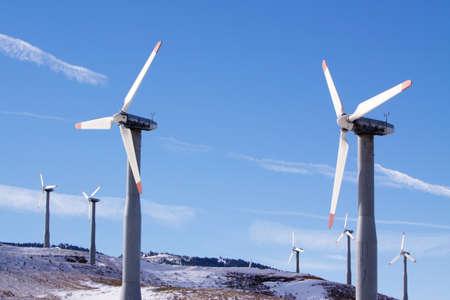 energies: Wind turbines in winter generating clean energy Stock Photo