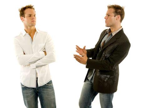 Twin males having a talk Stock Photo