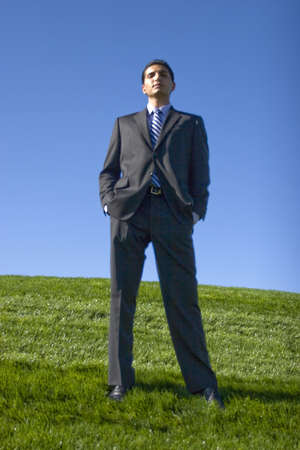 Young successful businessman posing outdoors photo