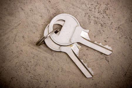 Two metal keys on grunge background Stok Fotoğraf