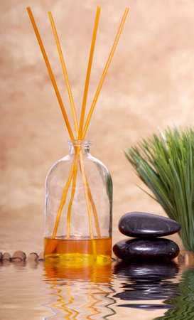 Fragrance sticks and massage therapy stones Stock Photo