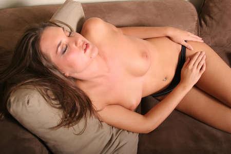 Sexy pretty woman sleeping topless photo