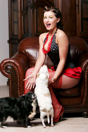 Pinup girl with puppies Stock Photo - 4407749