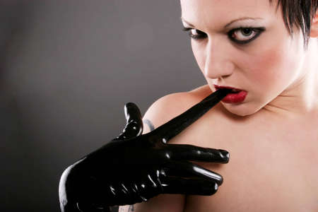Sexy woman in leather gloves Stock Photo - 4407330