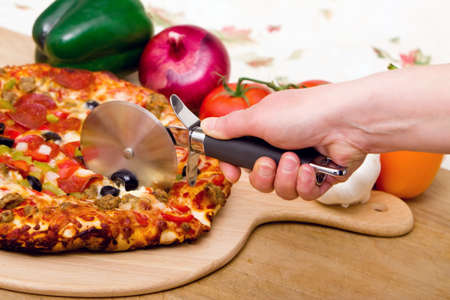 Delicious supreme pizza with meat and vegetables Stock Photo