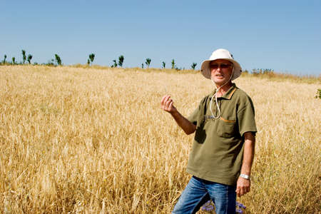 Farmer man working at a wheat field