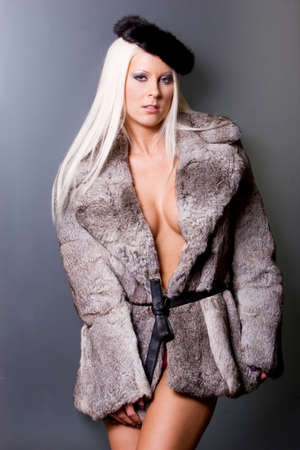 Sexy blonde woman in fur coat Banque d'images