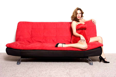 Pretty woman sitting on a sofa photo