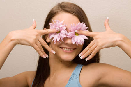 french manicure sexy woman: Girl covering her eyes with daisies