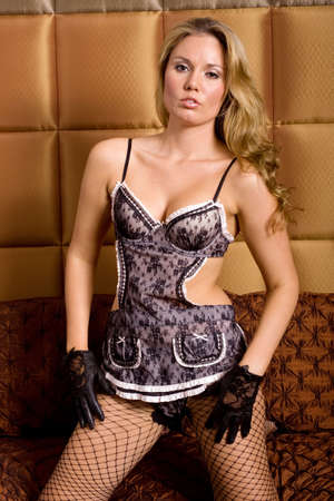 Sexy girl wearing french maid lingerie photo