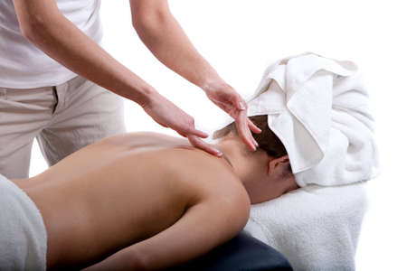deeptissue: Massage therapist doing a back and neck massage