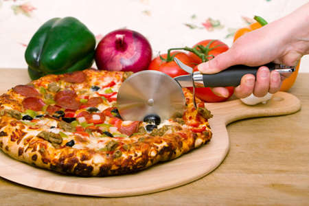 Delicious supreme pizza with meat and vegetables Stock Photo - 4745402