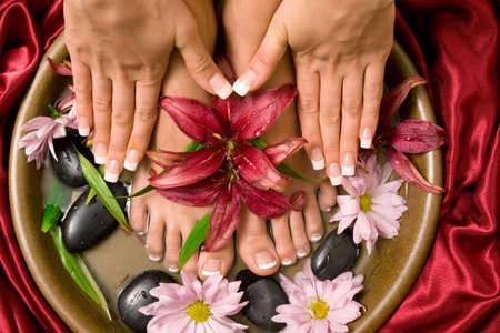 handcare: Womans french manicure and pedicure Stock Photo