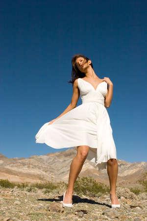 Beautiful fashion girl in white dress