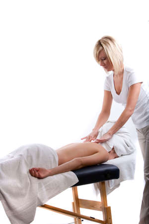 Massage therapist doing a back massage Imagens