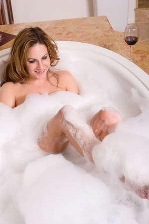 woman bath: Sexy woman taking a bubble bath in the bathtub