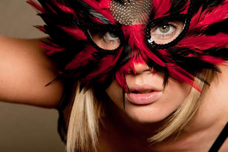 mardigras: Sexy blonde woman in carnival mask Stock Photo