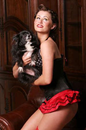 Pretty pinup girl with her puppy Stock Photo - 5107343